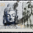 NEPAL - CIRCA 2003: A stamp printed in Nepal shows Buddha and SwayambhuNath, Kathmandu, circa 2003 - Stockfoto