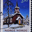 Royalty-Free Stock Photo: NORWAY - CIRCA 1993: A stamp printed in Norway shows the facade of a church with snow, circa 1993