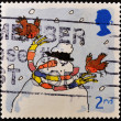 Royalty-Free Stock Photo: UNITED KINGDOM - CIRCA 2001: A stamp printed in England, is dedicated to Christmas, depicts snowman wearing a scarf, circa 2001