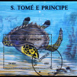 SAO TOME AND PRINCIPE - CIRCA 1992: A stamp printed in Sao Tome shows a turtle swimming, circa 1992 - Foto de Stock  