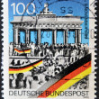 GERMANY - CIRCA 1990: A stamp printed in Germany commemorates the fall of the Berlin Wall on November 9, 1989, circa 1990 - Stock Photo