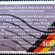 Stock Photo: GERMANY - CIRC1990: stamp printed in Germany, shows charter of GermExpellees, circ1990.