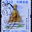 A stamp printed in Hong Kong shows buddha at po lin monastery — Stock Photo