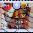 Stamp shows hand holding a compact disc - Stock Photo