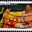 Stamp shows the painting &quot;Tahitian Beach&quot; by Paul Gauguin - Stock Photo