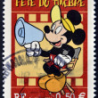 Stamp shows Mickey Mouse as a film director - Stock Photo