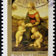 Stamp shows the Madonna of the Meadow, painting created by artist Raphael - Stock Photo