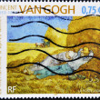 Stamp shows Afternoon nap or Meridienne painted by Vincent Van Gogh - Stock Photo