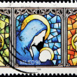 Stamp shows drawing of a window with the virgin and the child — Stock Photo