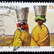 Stock Photo: Stamp shows Women fetching water from the river on their heads
