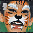 Stock Photo: Stamp is dedicated to painted faces of children, Tiger