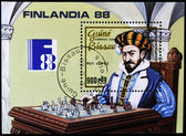 Stamp shows costumed man playing chess — Stock Photo
