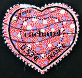 Stamp shows a heart by Cacharel — Stock Photo