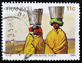 Stamp shows Women fetching water from the river on their heads — Stock Photo