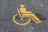 Yellow road marking for disabled and invalid parking — Stock Photo