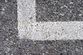 Asphalt background whit white angled stripe — Stock Photo