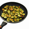 Cooked cougrettes with rosemary in frying pan on white background — Stock Photo