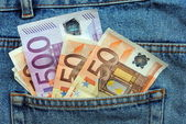 Euro bills in a blue jeans pocket — Stock Photo