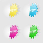 "A set of stars with the words ""New!"" — Stock Vector"