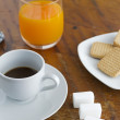 Espresso, juice and cookies — Stock Photo