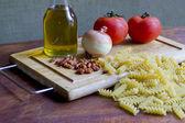 Raw pasta with ingredients — Stock Photo