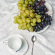 Stock Photo: Cup and grapes