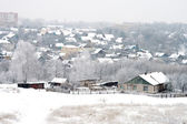 Winter snow-covered house in the province — Stock Photo