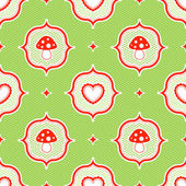 Green polka dot pattern with red toadstool mushroom and heart seamless — Stock Vector