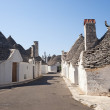 Stock Photo: Alberobello (Bari, Puglia, Italy): Street in the trulli town