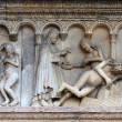Modena (Emilia-Romagna, Italy) - Cathedral facade, bas-relief - Stock Photo