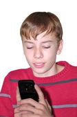 Мальчик держит в руках мобильный телефон — Stock Photo