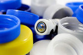 Alkaline battery with bottle caps — Stock Photo