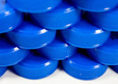 Plastic Bottle Caps in a row — Stock Photo