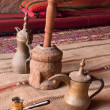 Arabic coffee pots,Grinder in a Bedouin tent — Stock Photo #7187544