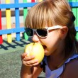 Stock Photo: Girl and apple