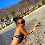 The girl sunbathing on a beach — Stock Photo #7248554