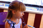 The little girl in cafe — Stock Photo