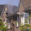 Smoldering Roof - Stock Photo