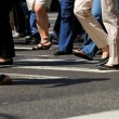 Stock Photo: Crowd crossing street in city