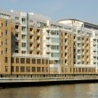 Modern apartment buildings waterside — Stock Photo #6775258