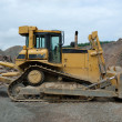 Huge bulldozer in a stone pit — Stock Photo #6776117