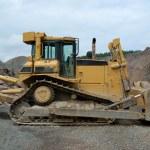 Huge bulldozer in a stone pit — Stock Photo