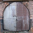 Stock Photo: Door of old warehouse