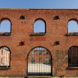 Stock Photo: Remains of old brick warehouse dockside