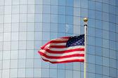 American flag against a skyscraper facade, New York — Stock Photo