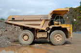 Big dumper truck in a stone pit — Stock Photo