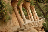 Columns designed by Antoni Gaudi. Park Guell in Barcelona Spain — Stock Photo
