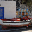 图库照片: Old fishing boat at port of Santorini, Greece