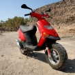 Red scooter — Stock Photo #6866865