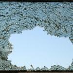 Crushed blue toned glass closeup — Stock Photo